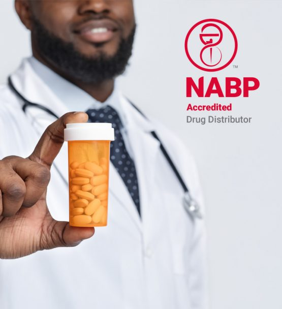 Pharmacist Holding Up Pharmaceuticals from NABP Accredited Drug Distributor
